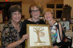 UCJF Coordinator Arlene Gould with FfA Founders jeweler Judy Polinsky event chair Barbara Cohen with 20th Anniv logo by Glenn Grubard